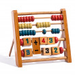 Wooden abacus with numbers and counters — Stock Photo #42522565