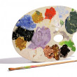 Artists palette with colorful paints — Stock Photo