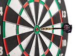 Dart in the centre of a dart board — Stock Photo