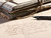 Writing a letter with a retro fountain pen — Stock Photo