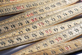 Background of wooden meter rulers — Stock Photo