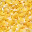 Background of delicate yellow flower petals — Stock Photo #43900785