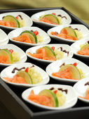 Smoked salmon appetizers on a buffet table — Stock Photo