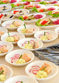 Assorted individual salads on a buffet — Stock Photo