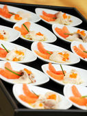 Gourmet fresh smoked salmon appetisers — Stock Photo
