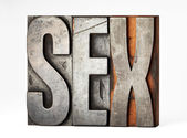 Vintage printers blocks or sorts spelling - Sex — Stock Photo