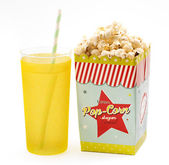 Box of popcorn with a soft drink — Stock Photo