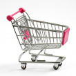 Metal shopping cart or trolley on white — Stock Photo #50123375