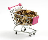 Shopping cart full of gold coins — Stock Photo