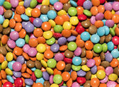 Background texture of brightly colored sweets — Stock Photo