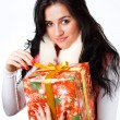 Beautiful girl with a gift in a pink coat on a white background - Foto de Stock