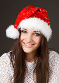 Beautiful girl in a Santa Claus hat — Stock Photo