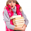 Stock Photo: Beautiful girl in winter clothing vith books