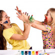 Stock Photo: Girls paint each other's colors
