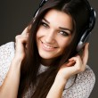 Stock Photo: Beautiful girl in headphones
