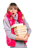Beautiful girl in winter clothing vith books — Stock Photo