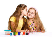 Two girls painted with colorful paint — Stock Photo
