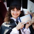 Beautiful girl with a diploma - Stock Photo