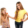 Two girls with candy — Stock Photo
