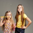 Two girls play bubble — Stock Photo #21239157