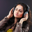 Beautiful brunette in headphones — Stock Photo