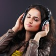 Beautiful brunette in headphones - Stockfoto