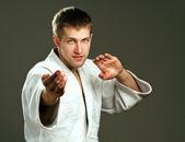 Man in a white kimono — Stock Photo