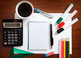 Desk with sheet of paper and stationery objects — Stock Photo