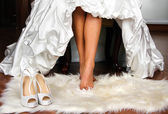 Feet of the bride — Stock Photo