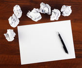 Blank paper with pen — Stock Photo