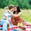 Happy young couple spending time together in park — Stock Photo