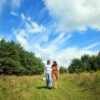 Couple in love walking in nature - Stock Photo