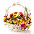 Basket decorated with flowers — Stock Photo