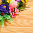 Floral arrangement with blank — Stock Photo