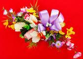 Arrangement of artificial flowers — Stock Photo