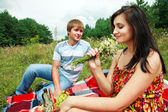 Happy young couple spending time together in park — Foto Stock