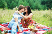 Happy young couple spending time together in park — ストック写真