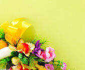 Floral arrangement on a yellow background — Stock Photo
