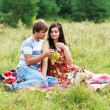 Happy young couple spending time together in park — Stok fotoğraf