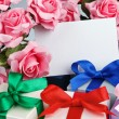 Greeting card with flowers and gifts — Stock Photo #35740049