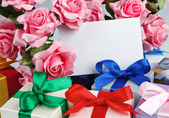 Greeting card with flowers and gifts — Foto de Stock