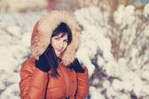 Beautiful brunette woman in winter — Stock Photo