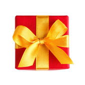 Single red gift box with golden ribbon — Foto de Stock