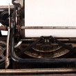 Blank sheet of paper in typewriter — Stockfoto