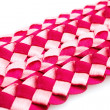 Intertwined red fabric — Stock Photo