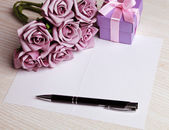 Blank card with flowers and gift — Stock Photo