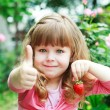 Little girl with strawberry, say OK — Stock Photo #43989287