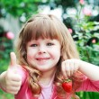 Little girl with strawberry, say OK — Foto de Stock