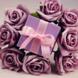 Violet flowers and gift box — Stock Photo #50947705