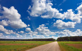 Rural landscape with road and clouds — Stock Photo
